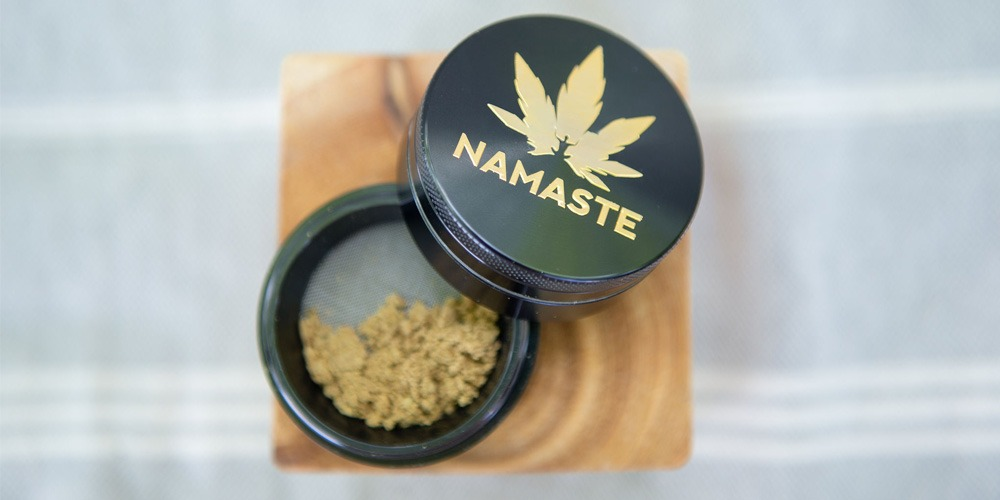 Kief decarboxylation - kief shown at the bottom of a namaste grinder