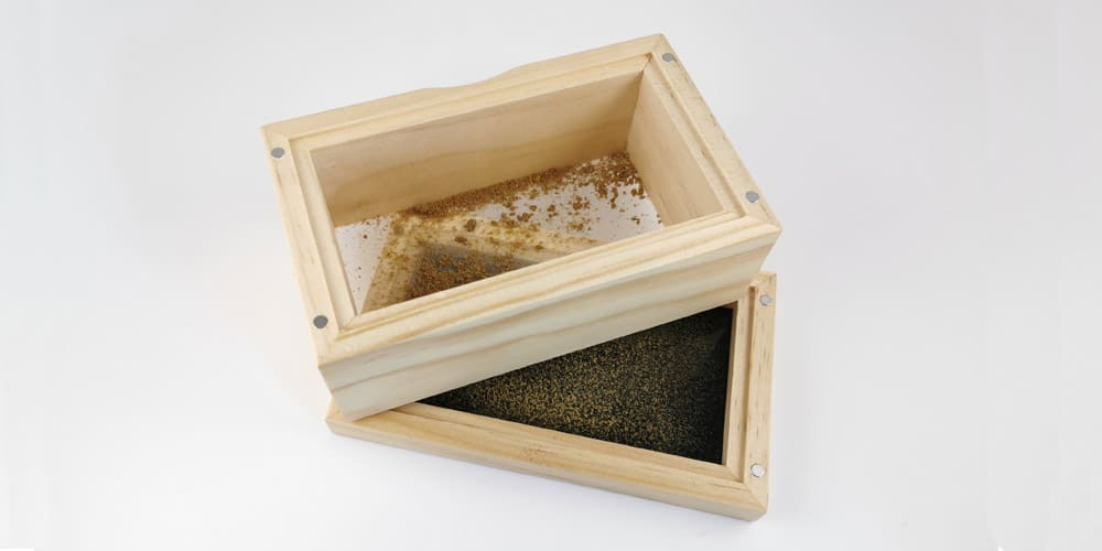 Kief collected in a sifter box